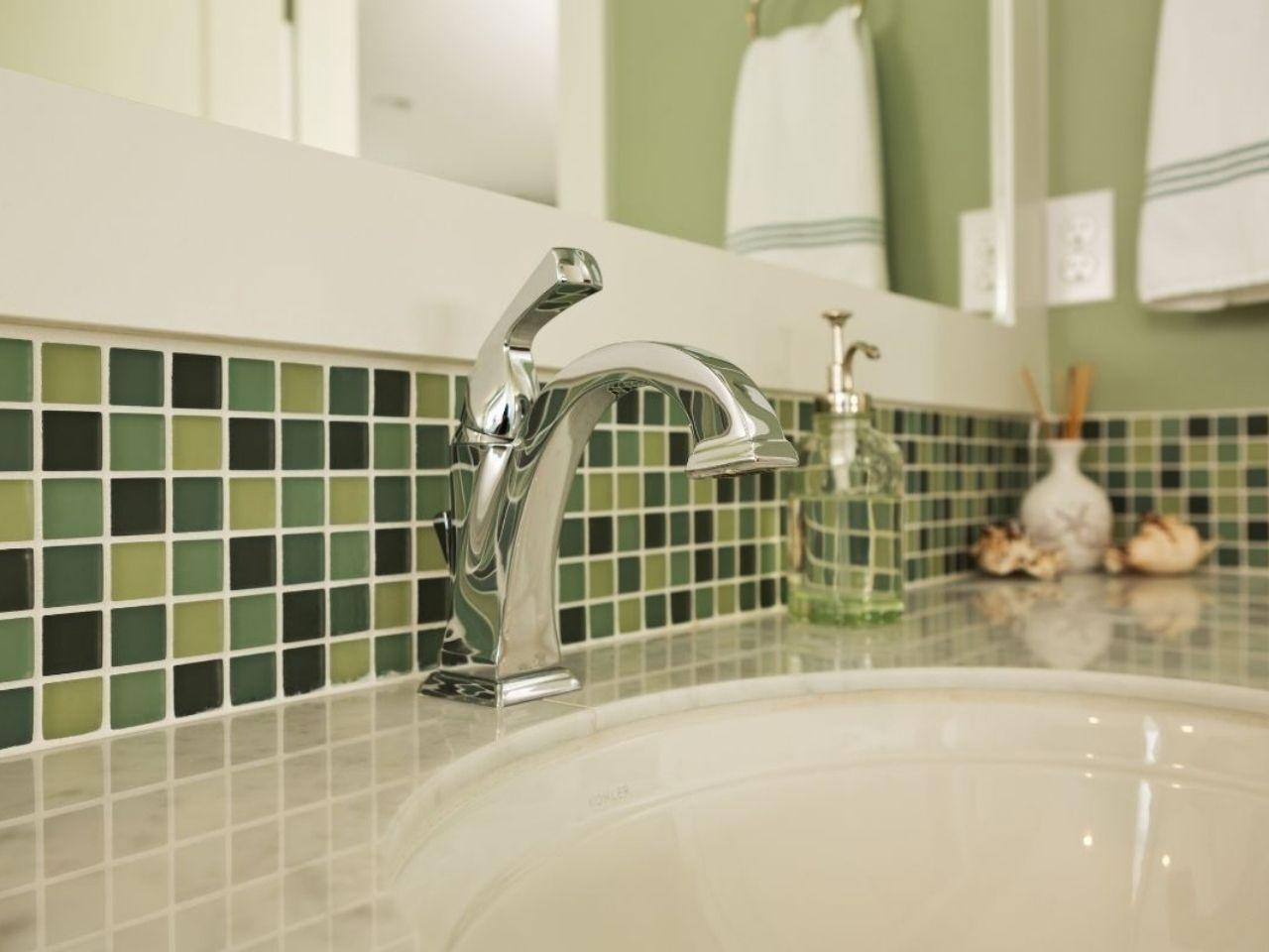 green tiles near sink